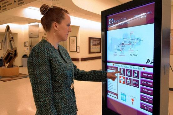 Sarah Hermsen, an employee at Rapid City Regional Hospital, demonstrates a direction-guiding digital kiosk. Regional Health