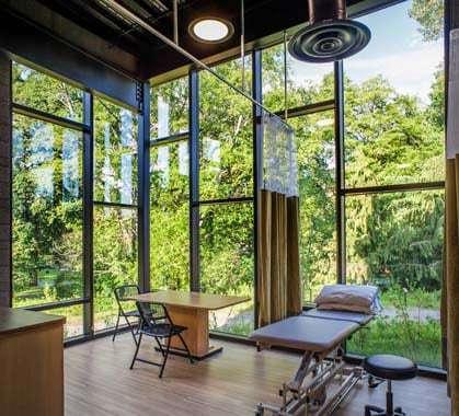 Warm modern design gives this rehabilitation center a for Atrium garden window